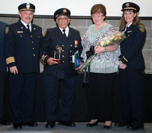 40 Years of Service Award (Suppression Division, then Public Education Division) From left to right: Fire Chief Ed Melanson, Public Educator Rohinton Mistry, Kathyrn Mistry, Public Education Captain Tracey Fitzsimons